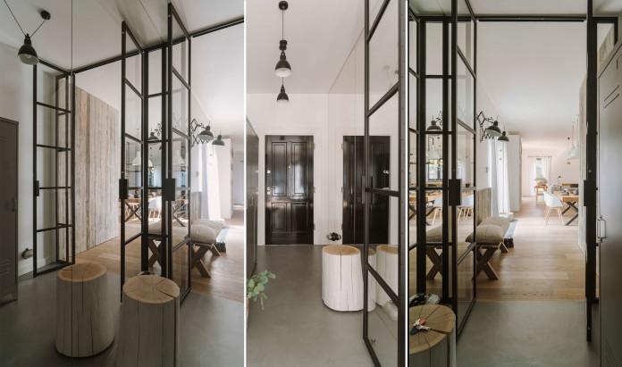 Szklane przegródki drewno inspiracje białe ściany czarne drzwi wejściowe