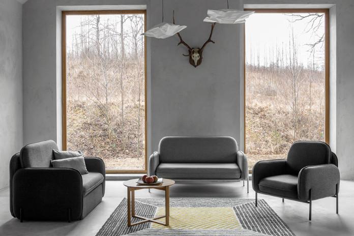 Najlepsi polscy projektanci inspiracje fotel sofa kanapa poduszki szarość beton stolik aranżacje dywan