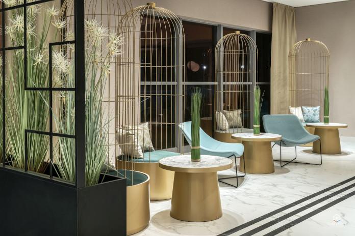 złoto zieleń czerń marmur hall lobby hotel